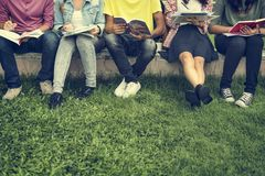 Young Diverse Group Studying Outdoors Concept. Diverse Student Outdorr Studying Concept Royalty Free Stock Image