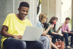 Young Diverse Group Studying Outdoors Concept Stock Photography