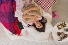 Young divorcee lying in bed Stock Images
