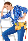 Young DIY handy woman with a problem Stock Images