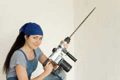 Young DIY woman holding an electric drill Stock Photos