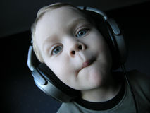 Young DJ 4. Young boy acting out music with huge earphones. Wideangle Royalty Free Stock Photo