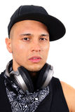 Young Dj. A young DJ with headphones in black Royalty Free Stock Photo
