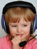Young DJ. Protrait of a little girl with headphones listening to music Stock Photography
