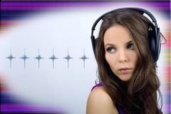 Young dj girl with headphones. Young dj girl in club clothes with headphones on bright background Royalty Free Stock Photography