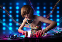Young Dj girl mixing records with colorful lights. Beautiful young Dj girl mixing records with colorful lights Stock Image