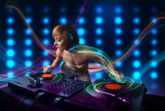 Young Dj girl mixing records with colorful lights Royalty Free Stock Photo