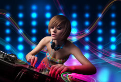 Young Dj girl mixing records with colorful lights. Beautiful young Dj girl mixing records with colorful lights Royalty Free Stock Photos