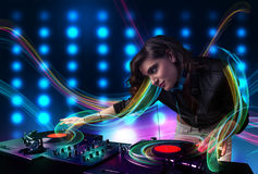 Young Dj girl mixing records with colorful lights. Beautiful young Dj girl mixing records with colorful lights Stock Photography
