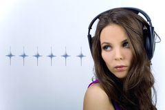 Young dj girl with stars. Young dj girl in club clothes with headphones on background with stars Royalty Free Stock Images