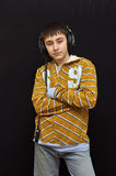 Young DJ with headphones Royalty Free Stock Images