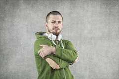 Young DJ with headphones on neck. Portrait Stock Photo