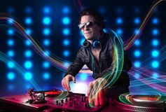 Young Dj mixing records with colorful lights. Attractive young Dj mixing records with colorful lights Stock Photo