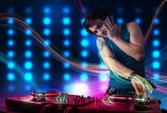 Young Dj mixing records with colorful lights. Attractive young Dj mixing records with colorful lights Stock Images