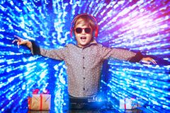 Little dj in sunglasses. A young dj playing music in sunglasses. Merry Christmas and Happy New Year stock images