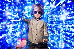 Young music player. A young dj playing music in sunglasses. Merry Christmas and Happy New Year royalty free stock image