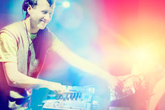 Young DJ playing records at a party in a nightclub. Young DJ playing records at a party in a nightclub Royalty Free Stock Photos