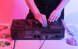Young DJ plays to musical device Royalty Free Stock Photography