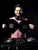 Young DJ in white costume holding vinyl record in. Isolated black bakcground Stock Photography