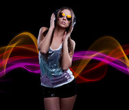Young DJ woman enjoying the music. In the headphones Stock Images