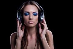Young DJ woman enjoying the music. In the headphones Stock Photo