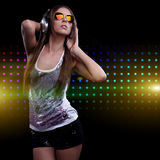 Young DJ woman enjoying the music. In the headphones Royalty Free Stock Photos