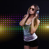 Young DJ woman enjoying the music Stock Image