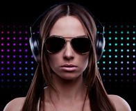 Young DJ woman enjoying the music. In the headphones Royalty Free Stock Image