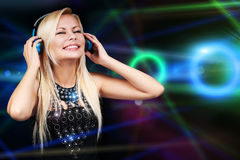 Young DJ Woman with Headphones. Happy Blonde Girl Stock Photos