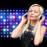 Young DJ Woman with Headphones. Happy Blonde Girl Royalty Free Stock Photography