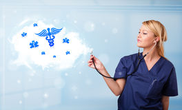 Young doctor with abstract cloud and medical icons Royalty Free Stock Photo