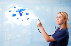 Young doctor with abstract cloud and medical icons Stock Image
