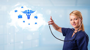 Young doctor with abstract cloud and medical icons Royalty Free Stock Photos
