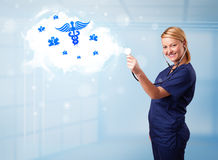 Young doctor with abstract cloud and medical icons Stock Photo