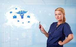 Young doctor with abstract cloud and medical icons Royalty Free Stock Photography