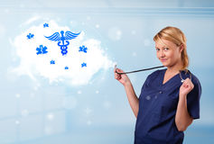 Young doctor with abstract cloud and medical icons Stock Images