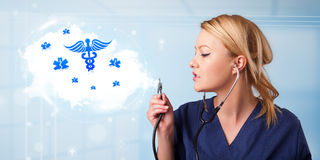 Young doctor with abstract cloud and medical icons Royalty Free Stock Image