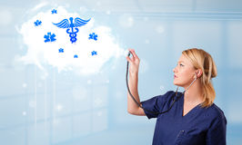 Young doctor with abstract cloud and medical icons Stock Photography