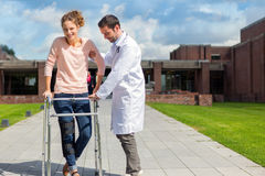 Young doctor assisting a young woman Royalty Free Stock Photo