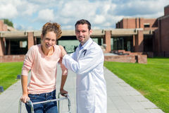 Young doctor assisting a young woman Stock Photography