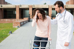 Young doctor assisting a young woman Royalty Free Stock Photography