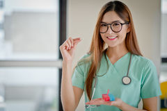The Young doctor with a box of pills in hand. Healthcare busines Stock Photos