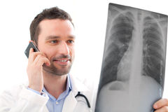 Young doctor calling patient for results Royalty Free Stock Photo