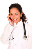 Young doctor calling by phone Stock Photos