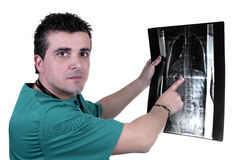 Young doctor check x-ray Royalty Free Stock Photos