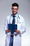 Young doctor with clipboard in hands Stock Photography