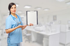 Young doctor with clipboard Stock Photo