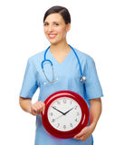 Young doctor with clock Royalty Free Stock Image