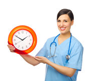 Young doctor with clock Stock Image