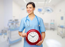 Young doctor with clock Stock Images
